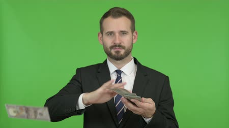 separation : Happy Businessman throwing out Money against Chroma Key Stock Footage