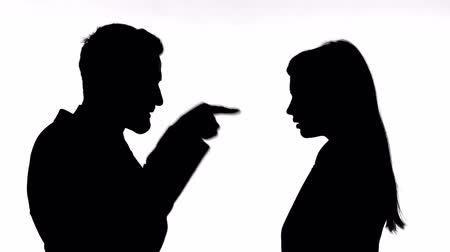 slapping : Silhouette of Man Slapping Woman Against White Background Stock Footage