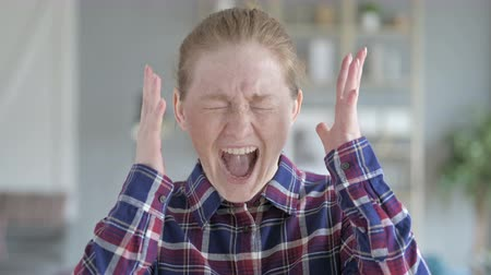 disapprove : Close Up of Young Woman Shouting in Anger