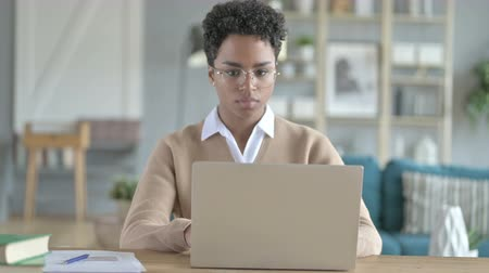 fatto : African Girl leaving laptop on Table After work Done