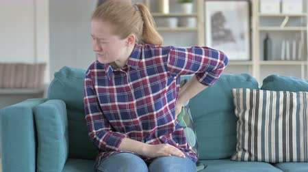 ból pleców : Young Woman having back pain