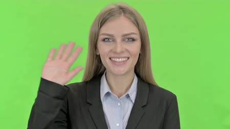 recortar : Cheerful Businesswoman Waving at Camera against Chroma Key Vídeos