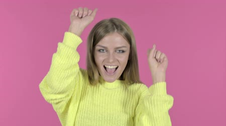 escuta : Excited Young Girl Dancing and Celebrating, Pink Background