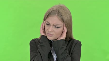 cansado : Tired Young Businesswoman having Headache against Chroma Key Stock Footage