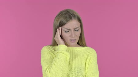 tahriş : Stressed Young Girl having Headache, Pink Background Stok Video