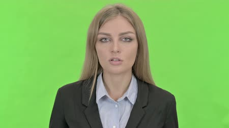 introspection : Professional Businesswoman having Conversation against Chroma Key Stock Footage