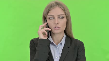 gritar : Ambitious Businesswoman Talking on Smartphone against Chroma Key Vídeos