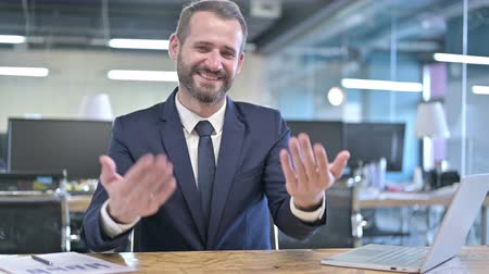 merging : Cheerful Young Businessman Pointing finger and Inviting