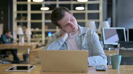 physical pressure : Tired Young Male Designer having Neck Pain in Office