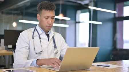 medical student : Focused Young Doctor Working on Laptop in Modern Office