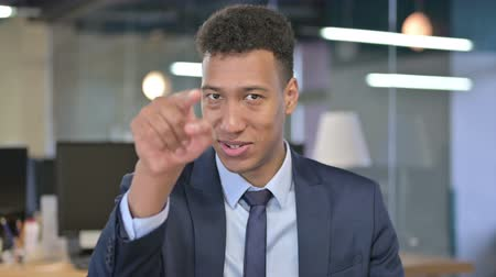 beckoning : Portrait of Young Businessman Pointing Finger and Inviting
