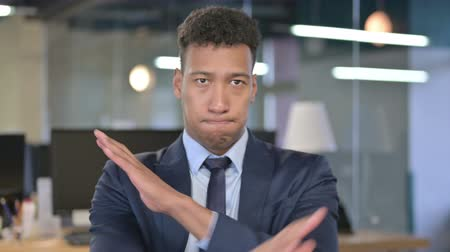 elválasztás : Portrait of Serious Young Businessman saying No by Hand Gesture Stock mozgókép
