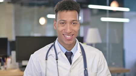 one man only : Portrait of Smiling Young Doctor Looking at the Camera
