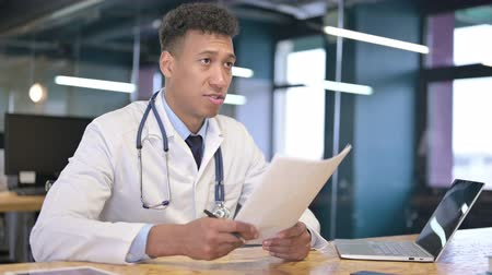counsel : Cheerful Young Male Doctor Giving Documents to Client Stock Footage