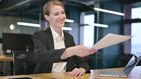 counsel : Cheerful Young Businesswoman Handing over Papers in Office
