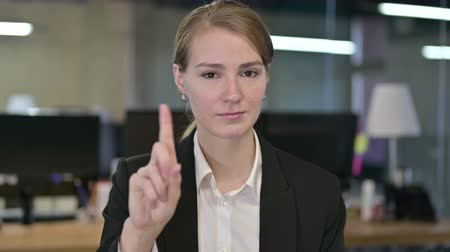 elválasztás : Portrait of Attractive Young Businesswoman saying No by Finger