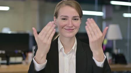 beckoning : Portrait of Young Businesswoman Pointing Finger and Inviting Stock Footage