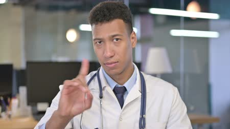 medical student : Portrait of Young Doctor saying No with Finger Sign Stock Footage