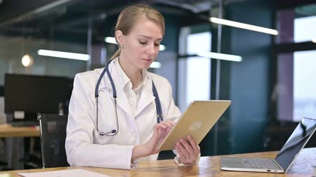 hardworking : Hardworking Young Female Doctor using Tablet in Office