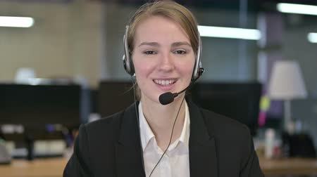 видео : Portrait of Young Businesswoman Video Chatting with Head Phones