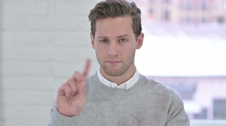adults only : Portrait of Creative Young Man saying No with Finger Sign Stock Footage