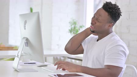 hardworking : Hardworking Casual African Man having Neck Pain
