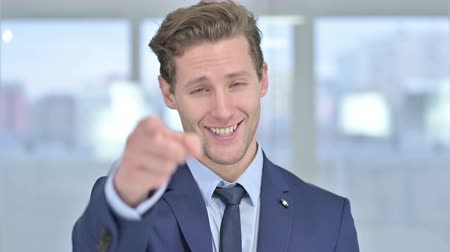 merging : Portrait of Young Businessman Pointing Finger at Camera Stock Footage