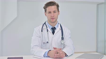counsel : Professional Young Male Doctor doing Consultation with Patient Stock Footage