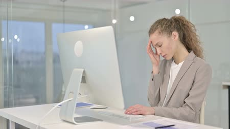 tahriş : Tired Young Businesswoman having Headache in Office