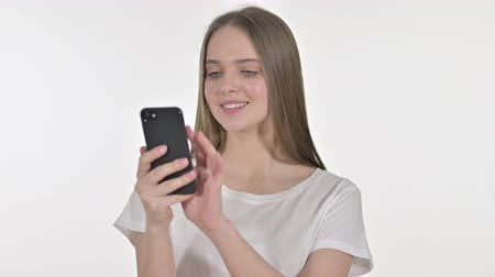 negotiate : Beautiful Young Woman Talking on Smartphone, White Background