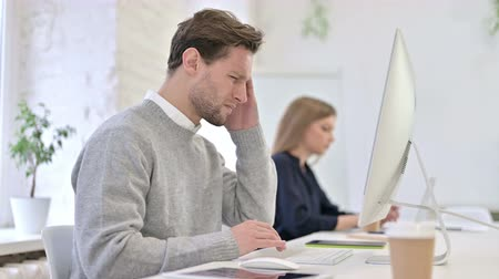 one man only : Tired Creative Male Professional having Headache in Office