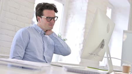 hardworking : Hardworking Working Young Man having Neck Pain Stock Footage