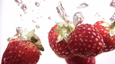 sabor : Strawberries falling in water slow motion. Stock Footage
