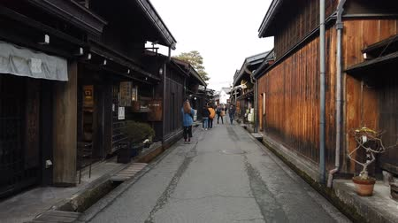 edo : Takayama, Japan - January 20, 2019 : Tourists walking in old town and traditional Japanese village in Takayama. Stock Footage