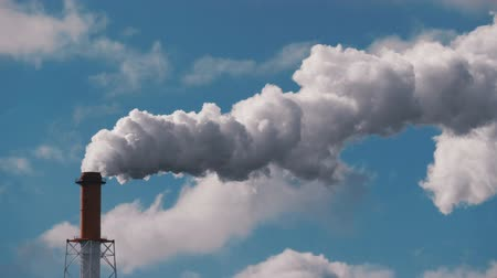 volatile : Smoke stack from industrial chimney, air pollution problem