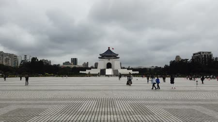 museum : Tourists at Chiang Kai Shek memorial hall in Taiwan. The building is famous landmark and must see attraction in Taipei.