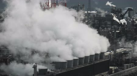 distillation : Steam or smoke from pipes in factory at industry area Stock Footage