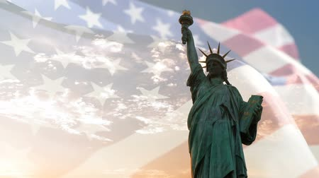 двойной : Statue of liberty and American flag waving with copyspace, double exposure.