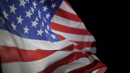 president of united states : USA American flag waving on black background.
