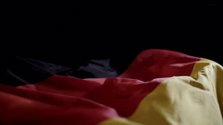 união europeia : Germany flag waving on black background with copyspace, slow motion. Stock Footage