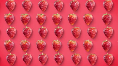Strawberry rotating on pink background looped, stop motion. Stok Video