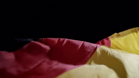 Flag of germany on black background, slow motion.