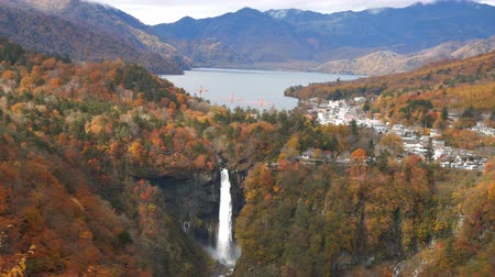 Beautiful Kegon waterfall with autumn tree and mountain in Nikko, Japan.