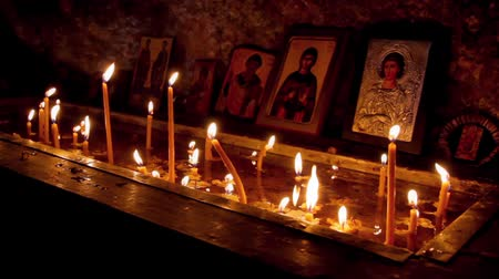 iconography : candles burning inside orthodox chapel Stock Footage