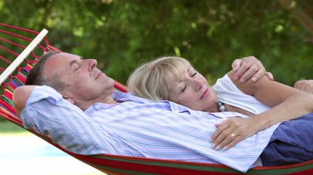 гамак : Couple relaxing together in hammock with eyes closed.  Стоковые видеозаписи