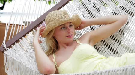 vacation : Woman Relaxing In Beach Hammock  Stock Footage