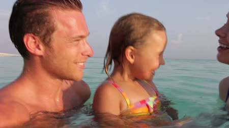 vacation : Family Relaxing In Tropical Sea