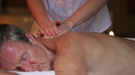 massages : Senior Man Having Massage In Spa Stock Footage