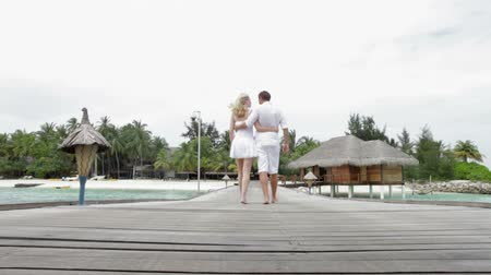 atracação : Couple Walking On Wooden Jetty