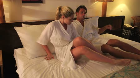 cama : Couple Relaxing In Hotel Room Wearing Robes